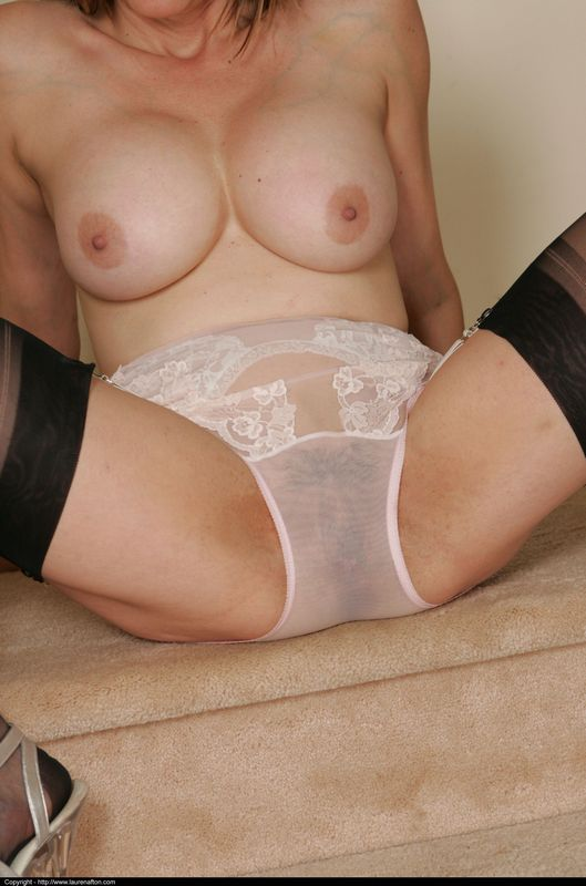 Mature busty lady in stockings and sheer slip strips 8