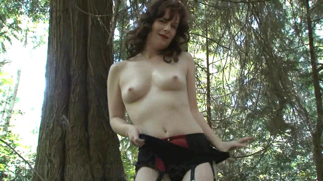 An amateur with a camera and a sexy model outdoors What a thrill for the photographer DirtyAngie is strolling in a public park in a sheer full length nylon slip and you can clearly see her black and red six strap suspender belt big black panties stockings and a red bra She walks down a path and shows off her slip and underwear as the lucky guy films her You can tell he is a bit shakey at times but who wouldnt be Sexy Angie strips out of her slip and continues walking in her panties garter belt stockings and bra wow what a sight